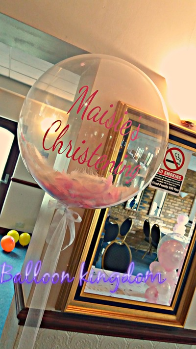 Pink feather filled bubble balloon