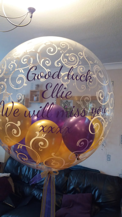 Clear personalised bubble balloon with mini balloons inside