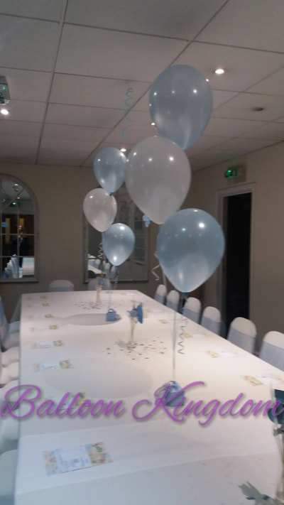 baby blue and white balloons