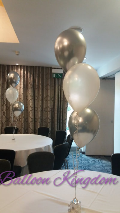 silver chrome and white balloon cluster